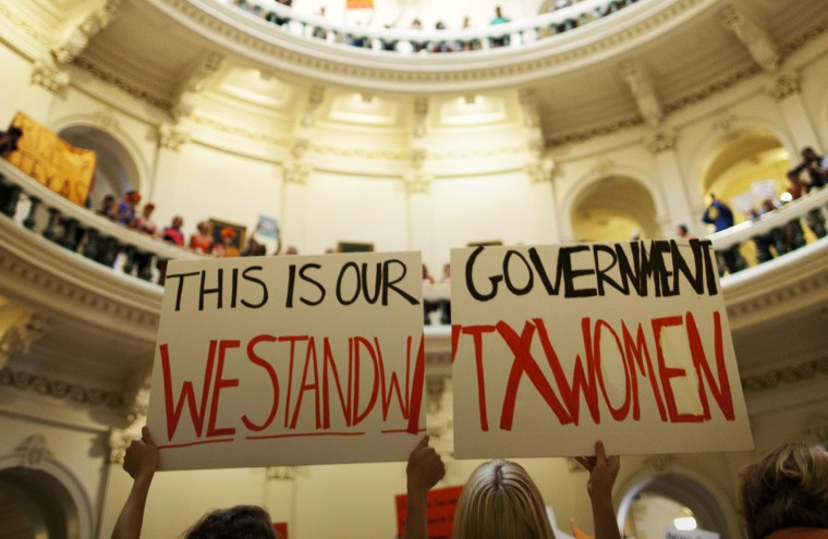 Abortion rights supporters rally on the floor of the State Capitol rotunda in Austin, Texas, July 12, 2013.