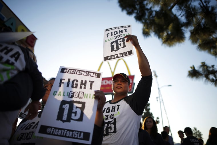Demonstrators take part in a protest to demand higher wages for fast-food workers outside McDonald's in Los Angeles, California May 15, 2014.