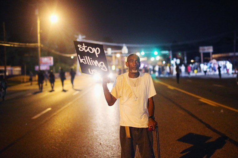 Frederick Scott protests the killing of teenager Michael Brown on Aug. 18, 2014 in Ferguson, Mo.