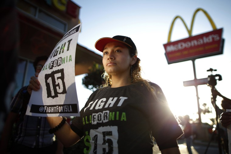 Demonstrators take part in a protest to demand higher wages for fast-food workers outside McDonald's in Los Angeles, Cali. on May 15, 2014.