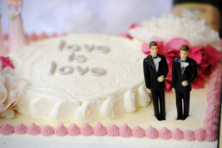 A wedding cake with a male couple is seen at a same-sex marriage celebration, July 1 2013.