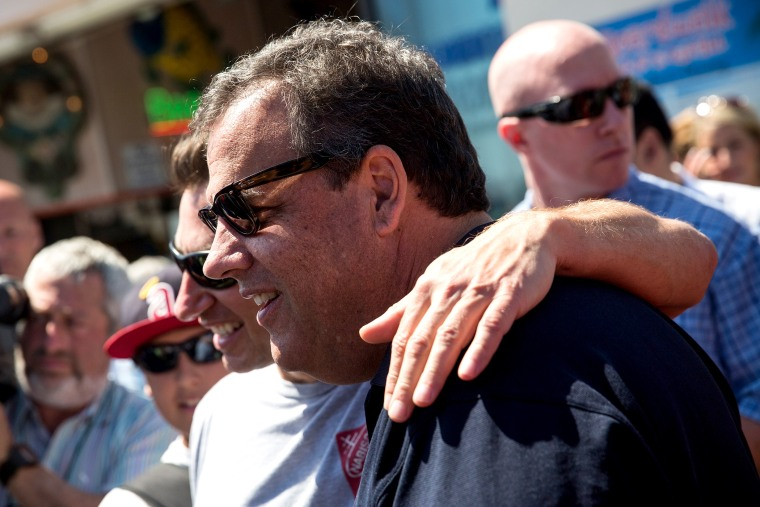 New Jersey Governor Chris Christie takes a photo with a fan while touring the boardwalk on August 29, 2014 in Point Pleasant, New Jersey.