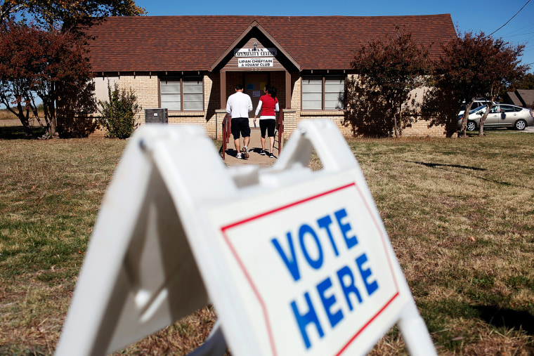 Voters exit a polling location after voting on November 6, 2012 in Lipan, Texas.