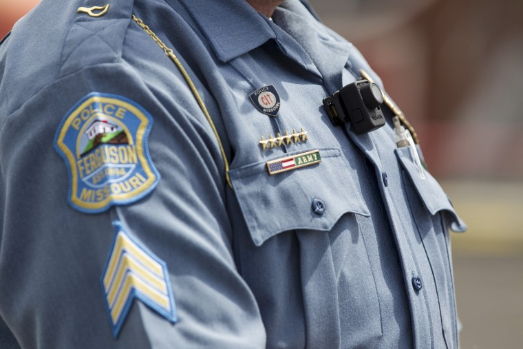A Ferguson police officer wears a body camera during a news conference in Ferguson, Mo., Sept. 1, 2014.