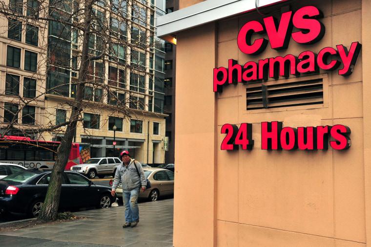 A man passes a CVS drugstore in Washington, DC., February 5, 2014.