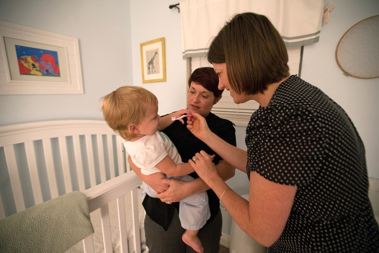 Jackie and Lauren Brettner, photographed at their New Orleans home with their 16-month old daughter Sophie, Wednesday, August 20, 2014, are plaintiffs in a lawsuit seeking to strike down Louisiana's amendment banning same-sex marriage.