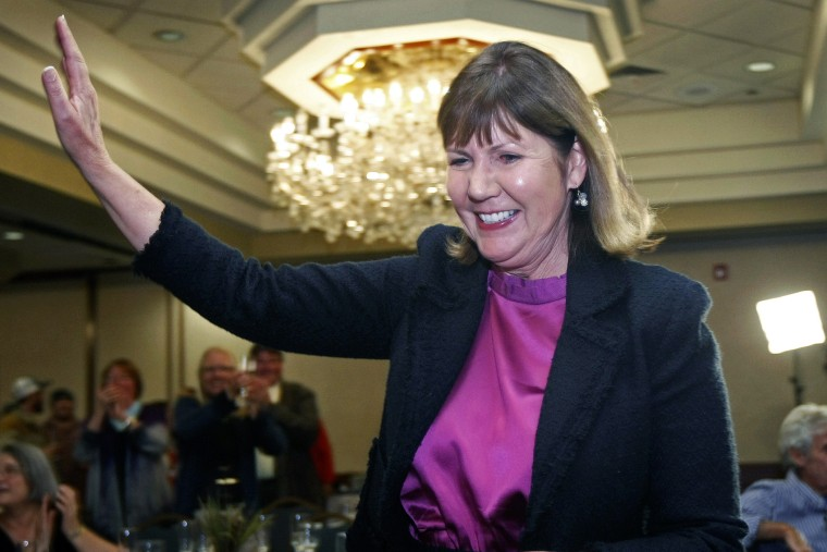 Ann Kirkpatrick waves as she enters a room full of supporters during an election night in Flagstaff, Ariz., Nov. 6, 2012.