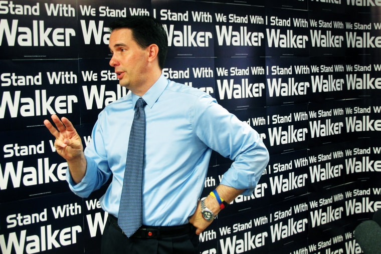 Wisconsin Gov. Scott Walker talks about a drop in state tax collections and a weak jobs report on Aug. 29, 2014, in Madison, Wis.