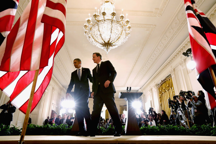 President Barack Obama (L) and British Prime Minister David Cameron leave the stage after holding a joint news conference in the East Room at the White House May 13, 2013 in Washington, D.C.