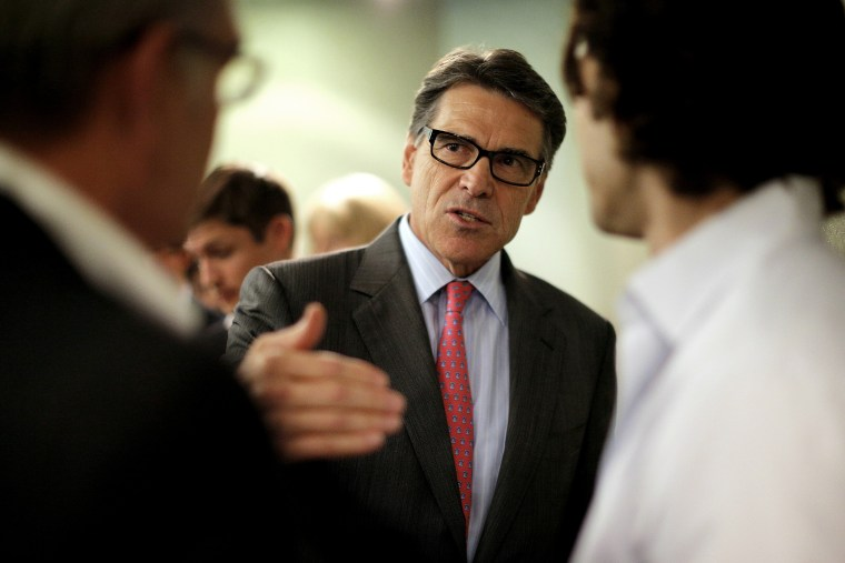 Texas Governor Perry, a possible Republican candidate for 2016 presidential race, talks several participants at business leaders luncheon in Portsmouth