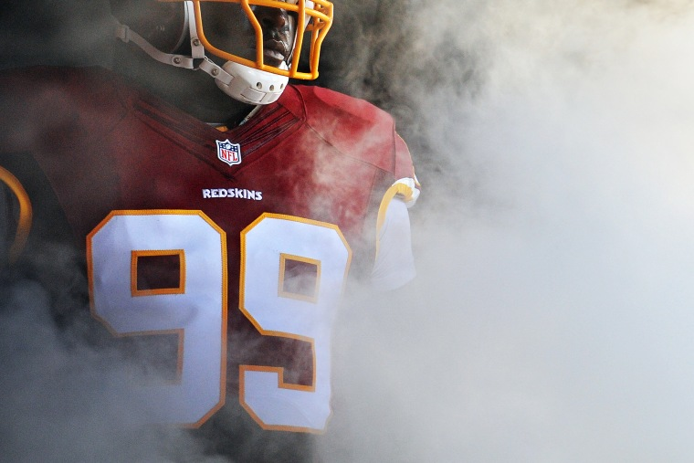A player on the Washington Redskins waits to be introduced before playing during a preseason NFL game on Aug. 7, 2014 in Landover, Md.
