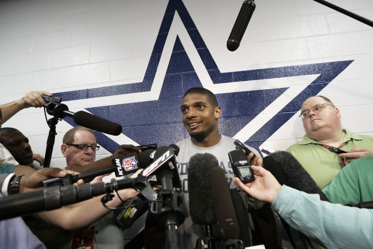 Dallas Cowboys practice squad player defensive end Michael Sam smiles as he speaks to reporters after team practice at the team's headquarters, Sept. 3, 2014, in Irving, Texas.