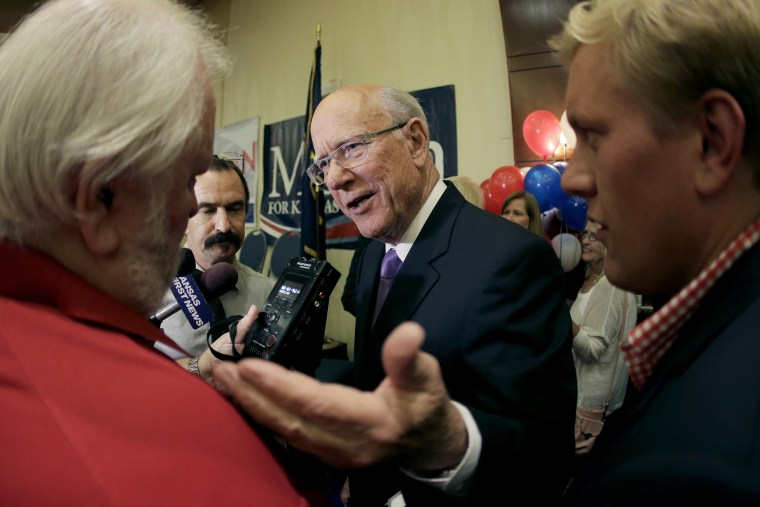 U.S. Sen. Pat Roberts talks to the media after making his victory speech at an election watch party, Aug. 5, 2014, in Overland Park, Kan.