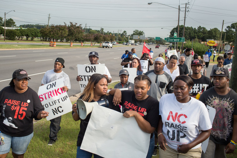 From left: Robin Walker who works at a KFC in Williamston, Ashley Wesley who works at a McDonald's in Raleigh, Jesseia Jackson, who works at a Biscuitville in Durham, and Tyaisha Williams of Raleigh march along South Wilmington Street to a nearby Burger King in Raleigh, N.C on Sept. 4, 2014.