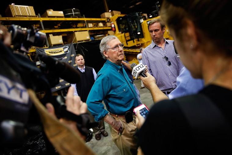 Senate Minority Leader Mitch McConnell (R-Ky.) takes questions from members of the press after speaking at Whayne Supply headquarters while campaigning during a two day bus tour of eastern Kentucky Aug. 7, 2014 in Corbin, Ky.