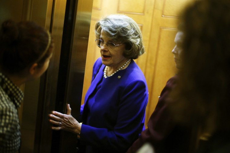 U.S. Senator Dianne Feinstein (D-Calif.) talks to a reporter as she departs following the weekly Democratic caucus policy luncheon at the U.S. Capitol in Washington, D.C., June 24, 2014.