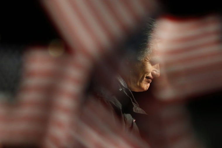 Former Republican presidential nominee Mitt Romney pauses while speaking at a campaign rally in Newport News, Va., Nov. 4, 2012.