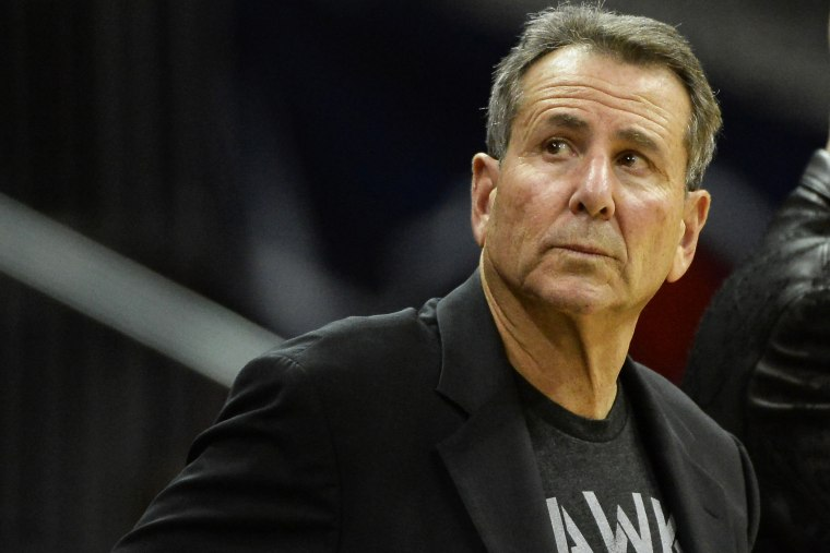 Atlanta Hawks co-owner Bruce Levenson watches from his courtside seat in the second half of their NBA basketball game against the Washington Wizards, Dec. 13, 2013, in Atlanta, Ga.