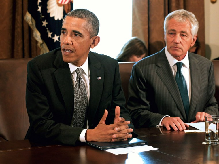 U.S. President Barack Obama makes briefs remarks to the news media at the beginning of a cabinet meeting with Defense Secretary Chuck Hagel in the Cabinet Room of the White House, September 12, 2013 in Washington, D.C.
