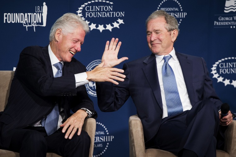 Bill Clinton and George W. Bush shake hands during the launch of the Presidential Leadership Scholars Program in Washington, DC, September 8, 2014.