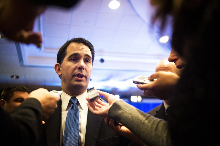 Wisconsin Gov. Scott Walker speaks to the reporters in Washington, D.C., Feb. 22, 2014.