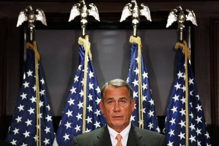 John Boehner takes reporters' questions following a closed-door conference meeting on Capitol Hill, Sept. 9, 2014.