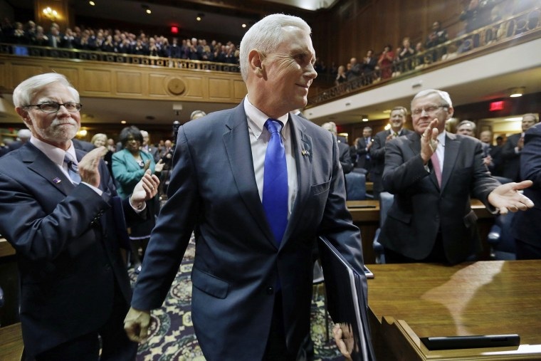 Indiana Gov. Mike Pence walks to the podium to give his State of the State address on Jan. 14, 2014, in Indianapolis.