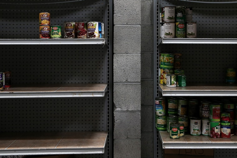 Shelves of canned foods sit partially empty at the SF-Marin Food Bank on May 1, 2014 in San Francisco.