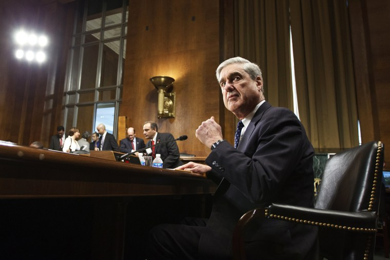 Then FBI Director Robert Mueller arrives on Capitol Hill in Washington, D.C., May 16, 2012, to testify during a hearing.