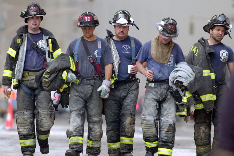 Firemen leave the rescue area near the World Trade Center after their shift on Sept. 13,  2001, in New York.