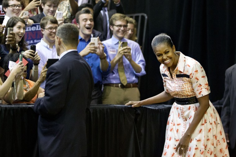 First lady Michelle Obama steps out from backstage as she's introduced by Democratic U.S. Senate candidate Michelle Nunn at a voter registration rally on Sept. 8, 2014, in Atlanta.  (David Goldman/AP)