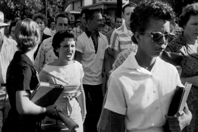 Students of Central High School in Little Rock, Ark., including Hazel Bryan, shout insults at Elizabeth Eckford as she marches down to a line of National Guardsmen, who blocked the main entrance and would not let her enter on Sept. 4, 1957.