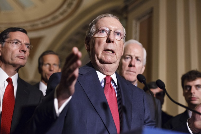 Senate Minority Leader Mitch McConnell speaks to reporters on Capitol Hill, Sept. 9, 2014. Photo by J. Scott Applewhite/AP.