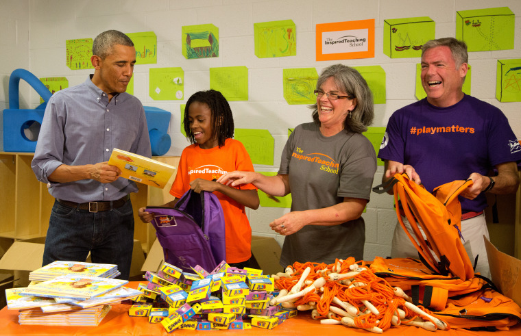 United States President Barack Obama and volunteers take part in a service project filling backpacks with books and toys for homeless children at the...