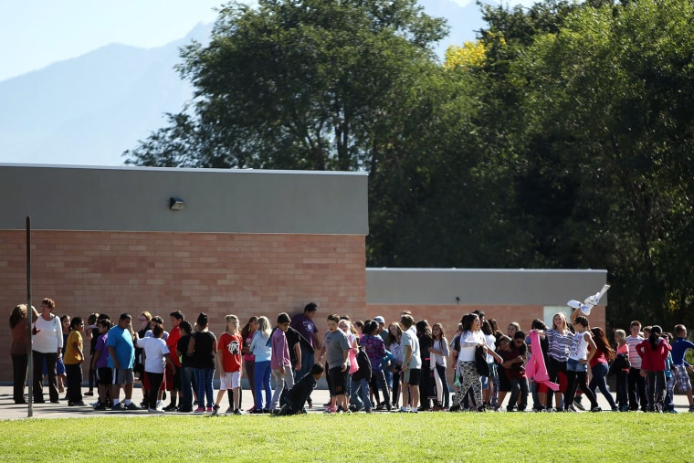 Students line up to go back inside after recess at Westbrook Elementary School in Taylorsville, Utah, Thursday, Sept. 11, 2014. Earlier, a teacher accidentally shot herself in the leg, while alone in a faculty bathroom, shortly before school started.