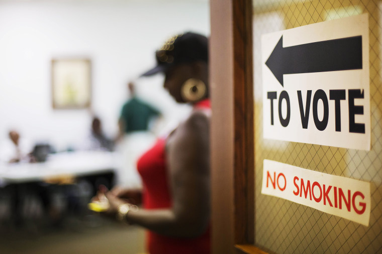 A sign directs voters at a polling site on July 22, 2014, in Atlanta, Ga.