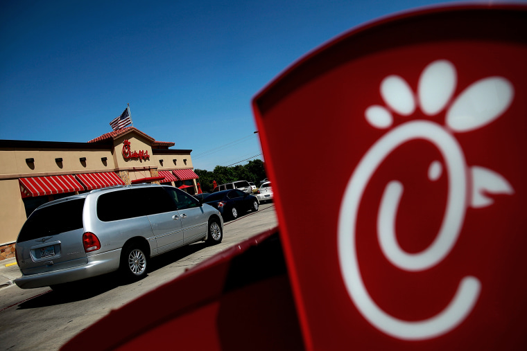 Drive through customers wait in line at a Chick-fil-A restaurant on in Fort Worth, Texas.  (Photo by Tom Pennington/Getty Images)
