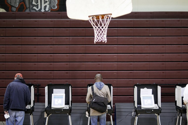 Voters cast their ballots at a polling site for Georgia's primary election, May 20, 2014, in Atlanta, Ga.