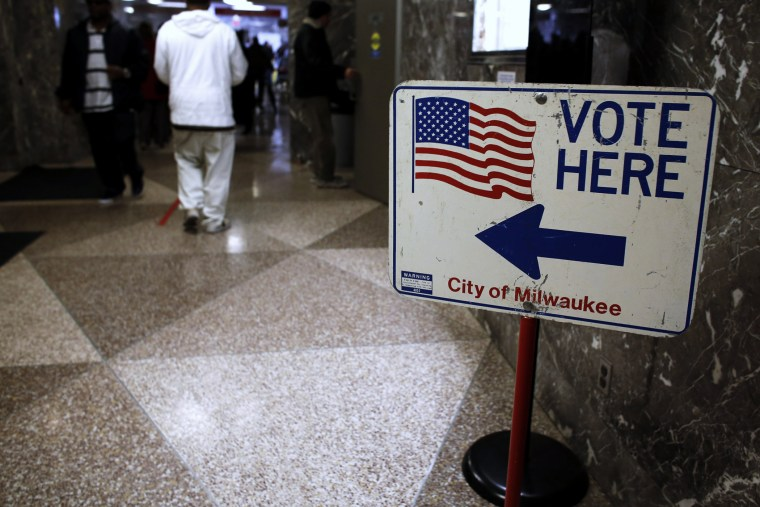 Residents wait in line during lunch hour to cast their early votes in the upcoming U.S. presidential elections in Milwaukee