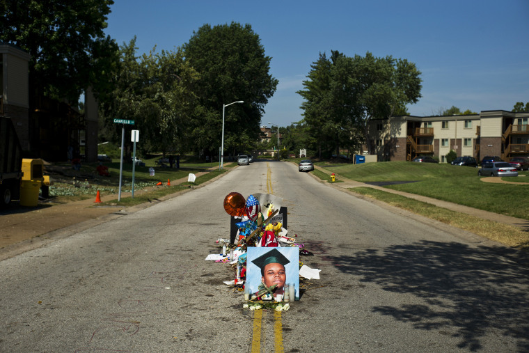 A makeshift memorial for Michael Brown, who was fatally shot by a police officer on Aug. 9, on the spot where he was killed in Ferguson, Mo., Aug. 26, 2014.