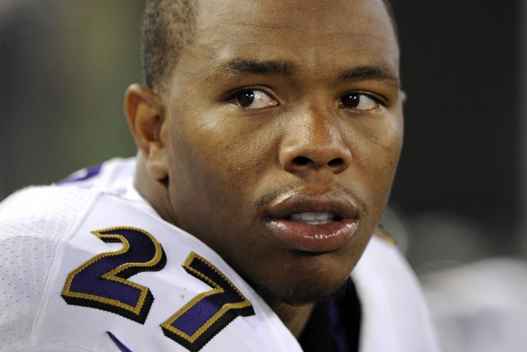 In this Aug. 7, 2014, file photo, Baltimore Ravens running back Ray Rice sits on the sideline in the first half of an NFL preseason football game in Baltimore, Md.