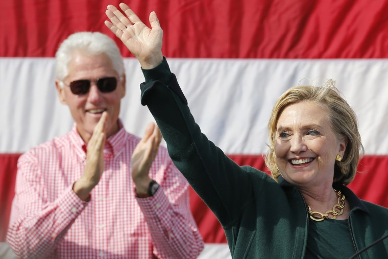 Former U.S. Secretary of State Hillary Clinton is applauded by her husband former U.S. President Bill Clinton at the 37th Harkin Steak Fry in Indianola, Iowa, Sept. 14, 2014.