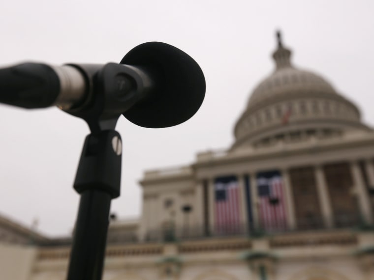 Image: The dome of the U.S. Capitol building is seen past a microphone during a rehearsal for the inaugural ceremonies in Washington
