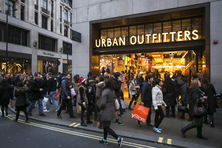 Shoppers walk outside an Urban Outfitters store, Dec. 2013.