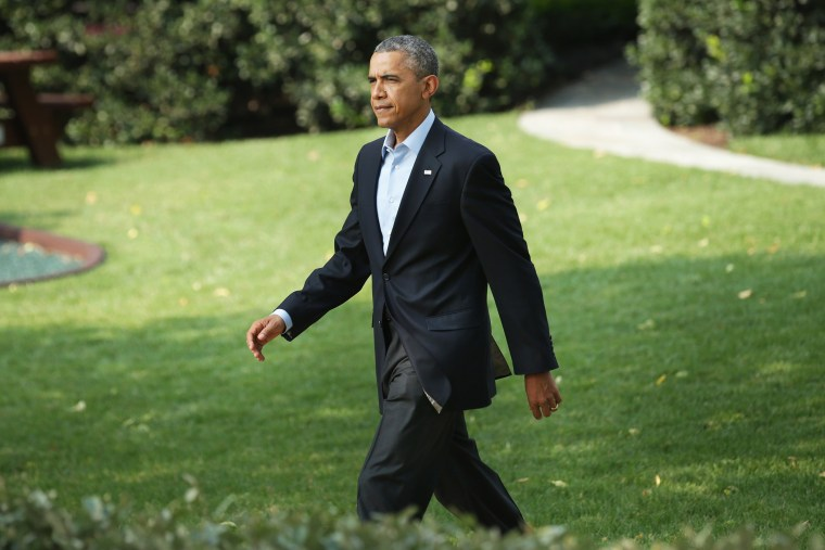 President Barack Obama walks out of the White House before making a statement on the South Lawn of the White House on Aug. 9, 2014 in Washington, D.C.