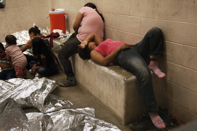 Immigrants who have been caught crossing the border illegally are housed inside the McAllen Border Patrol Station in McAllen, Texas on July 15, 2014, where they are processed. (Rick Loomis/Pool/Reuters)