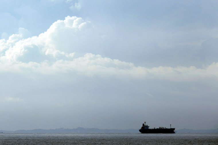A tanker travels through the Singapore Strait July 6, 2014.