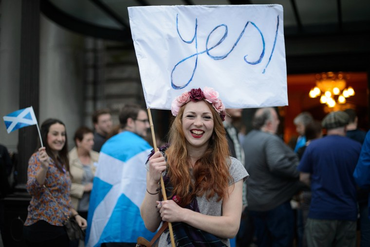 ""\""""Yes"""" campaign supporter waves a flag outside Usher Hall ahead of the """"A Night for Scotland"""" concert in Edinburgh, Scotland on Sept. 14, 2014.""760|507|?|en|2|f25214e0e526b0e93990414e8e03d673|False|UNLIKELY|0.34503817558288574