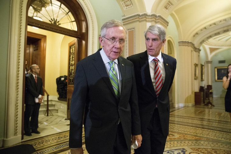 Sens. Harry Reid (D-Nev.) and Mark Udall (D-Colo) on Capitol Hill in Washington