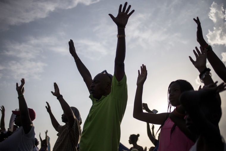 Supporters of Michael Brown, raise their hands in solidarity at the the Peace Fest 2014 rally in St. Louis, Missouri on Aug. 24, 2014. (Photo by Adrees Latif/Reuters)